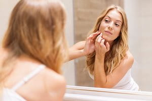 What is adult acne and what causes it?