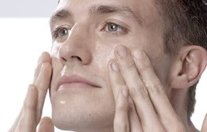 Man touching his face with both hands