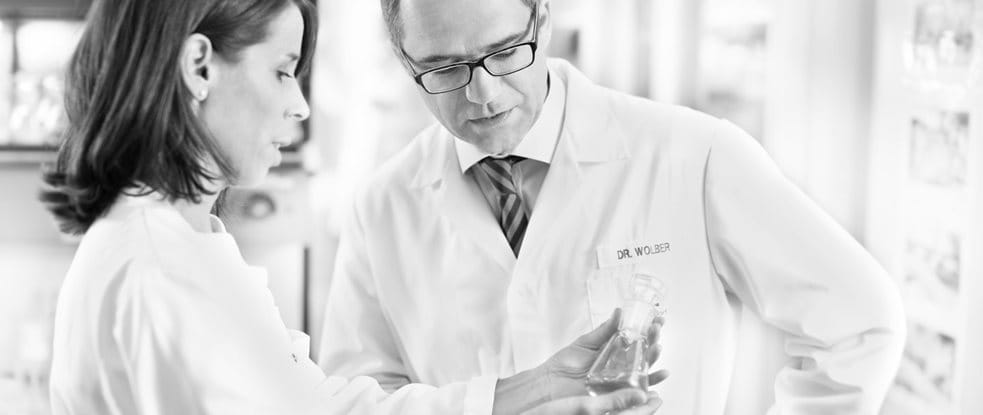 Dr. Rainer Wolber, Head of Product Development, DermoCosmetics is talking to a skincare scientist