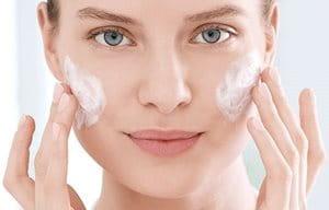 Women using Cleanser on cheeks