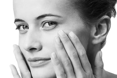 Woman with sensitive facial skin looking in the camera.
