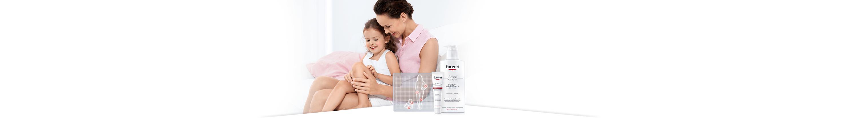 Žena s djetetom u rukama